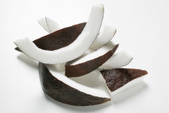 Coconut slices. Slices of coconut on a white background Royalty Free Stock Photo