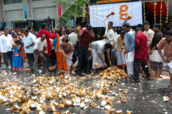 Coconut smashing in Penang Thaipusam Festival Stock Photos