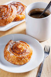 Coconut snail pastry and coffee for breakfast Royalty Free Stock Photo