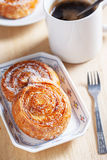 Coconut snail pastry and coffee for breakfast Royalty Free Stock Photos