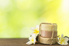 Coconut soap, mangosteen soap, rice milk soap. Placed on a wooden table with frangipani and natural background. Spa concept Royalty Free Stock Photography