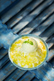 Coconut sorbet with mango sauce and vanilla ice cream Royalty Free Stock Photos