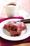 Coconut and sour cherry cake. Squares on plate Stock Image