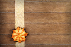Coconut star shaped christmas cookie on a ribbon Royalty Free Stock Photos