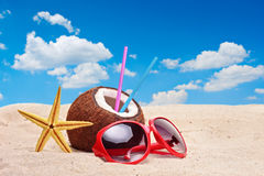 A coconut, starfish and a sunglasses Royalty Free Stock Photography