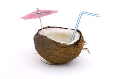 Coconut with staw and umbarella Stock Images
