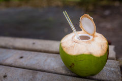 Coconut straw. Coconut with straw on the floor Stock Photo