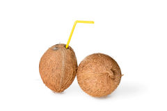 Coconut with a straw Stock Photo