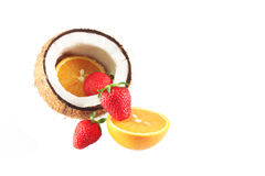 Coconut with strawberries and oranges Stock Photo