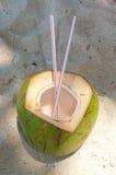 Coconut with straws Stock Photo