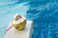 Coconut with straws to drink Royalty Free Stock Photos