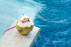 Coconut with straws to drink Royalty Free Stock Image