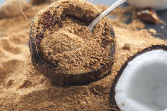 Coconut Sugar. Fresh coconut filled with organic coconut sugar royalty free stock photo