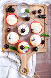 Coconut and sweet cherry cakes Royalty Free Stock Photography