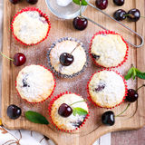 Coconut and sweet cherry cakes Stock Images