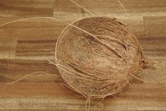 Coconut on a tabletop of acacia wood Stock Photo