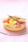 Coconut Tart with Fresh Grapefruit and Pineapple Gummies. On a light pink background Stock Photography