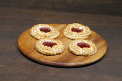 Coconut tartlets stuffed with strawberry jam Royalty Free Stock Images