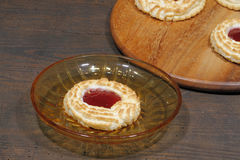Coconut tartlets stuffed with strawberry jam Stock Photography