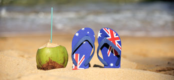 Coconut & thongs. Coconut with thongs on the beach in Salvador de Bahia, Brazil Royalty Free Stock Photo