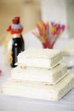 Coconut three layer cake. On the table ready for decoration Stock Photos