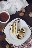 Coconut, vanilla buttercream and nuts cake Royalty Free Stock Photos
