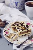 Coconut, vanilla buttercream and nuts cake Stock Photo
