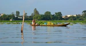 Coconut vendor. Mekong delta floating market. Long Xuyen. Vietnam Stock Images