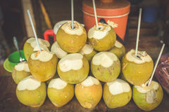 Coconut vendor, typical street food business in Asia Royalty Free Stock Images