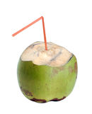 Coconut water. Green coconut with straw on isolated background stock photography