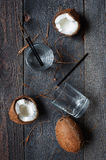 Coconut water and coconuts on the wooden table Stock Photos