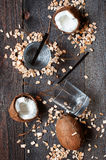 Coconut water and coconuts on the wooden table Royalty Free Stock Photo