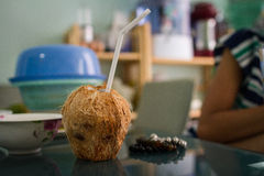 Coconut With White Straw Stock Photo