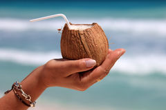 Coconut in a woman's hand Royalty Free Stock Image