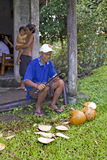 Philippines - Man, Machete & Coconuts Stock Photo