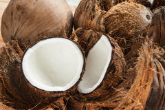 Coconuts. Two pieces of coconut on brown shell Stock Images