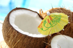 Coconuts. With umbrella by a pool Royalty Free Stock Photo