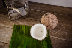 Coconuts on banana leaf and coconut grater Royalty Free Stock Photography