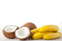 Coconuts and bananas on the white background horizontal Royalty Free Stock Photos