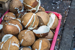 Coconuts in baskets Stock Photos