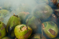Coconuts burning. The fresh coconuts from the garden to burn royalty free stock photography