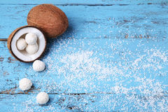 Coconuts. With candies on blue wooden table Stock Photo