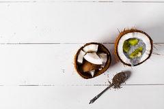 Coconuts with chia pudding. Royalty Free Stock Photography