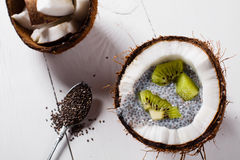 Coconuts with chia pudding. Stock Photo