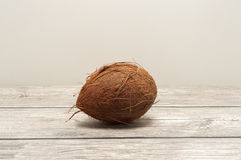 Coconuts close up on wooden board Stock Images