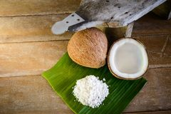 Coconuts and coconut flakes on banana leaf and coconut grater Royalty Free Stock Photo