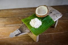 Coconuts and coconut flakes on banana leaf and coconut grater Stock Photography