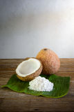 Coconuts and coconut flakes on banana leaf Stock Photo