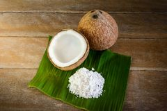 Coconuts and coconut flakes on banana leaf Royalty Free Stock Image