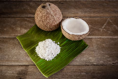 Coconuts and coconut flakes on banana leaf Royalty Free Stock Photos